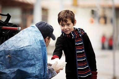 Boy feeding homeless